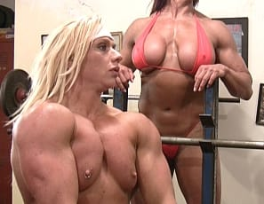 Amber Steel and Delphine are continuing their girl/girl gym workout, and they couldn't look ant stronger. Lots of big bicep action, powerful pecs and strong quad action. Wow! Why can't my spotter ever look like this? Anyway, if you love female muscle and you love watching to girls help each other out, you'll definitely love this scene!
