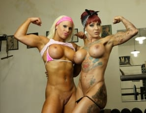 Female bodybuilder Megan Avalon and tattooed Dani Andrews are at the gym, posing, showing off their powerful pecs, muscular biceps and ripped abs, glutes and legs, then taking off their panties so you can enjoy some close-up ass play.
