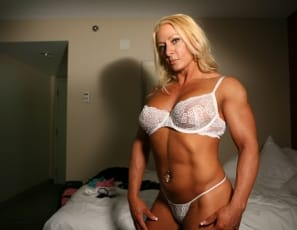 Hot female muscle lesbians Italian Muscle and Kim Ferrell explore each other's hot, muscled bodies in this sexy photo set shot in their hotel room. Featuring big pecs, sexy panties and high heeled shoes.
