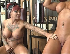 Female bodybuilder Megan Avalon trains her nude glutes and legs in the gym, while naked, tattooed Dani Andrews masturbates and worships the muscles of Megan's abs, biceps, and pecs and enjoys her muscle control. Watch the girl/girl action in close-up.