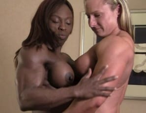 Female bodybuilders Darkside Milinda and Mistress Treasure get together in the Bedroom for some naked girl/girl fun, posing and worshiping each other's massive muscles and comparing asses. Treasure likes Darkside's tattoos, and Darkside admires her friend's ebony pecs, biceps, legs, glutes, and ripped abs. They both like each other's big clits. See all the play in close-up.