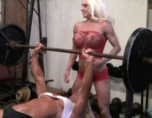 "Bodybuilders Ashlee Chambers and Darkside Milinda do bench presses together at the SheMuscle Gym. ""I love the way my chest feels when it gets pumped up,"" Ashlee says, finding a hands-on way to spot her topless partner. The girl/girl fun continues as the twosome inspect each other's naked pecs,, biceps, glutes and abs and Ashlee does calf raises and a lift-and-carry with Darkside on her back. By then you may be hands-on yourself!"