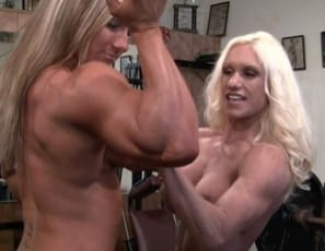 """Bodybuilders Ashlee Chambers and Darkside Milinda do bench presses together at the SheMuscle Gym. """"I love the way my chest feels when it gets pumped up,"""" Ashlee says, finding a hands-on way to spot her topless partner. The girl/girl fun continues as the twosome inspect each other's naked pecs,, biceps, glutes and abs and Ashlee does calf raises and a lift-and-carry with Darkside on her back. By then you may be hands-on yourself!"""