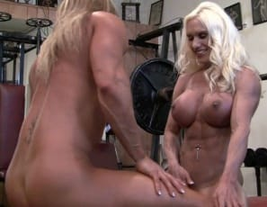 When bodybuilders Ashlee Chambers and Darkside Milinda work out nude together in the gym, they start with pull-ups and mutual lift and carry, then pose to show you how big, muscular, and vascular their legs, biceps, pecs and abs are. Afterwards, their stretch on the bench turns into a girl/girl clit-grinding session. Their big clits get even bigger, in an extreme close-up that will fill your screen while they fulfill each other.