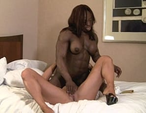 Bodybuilders Darkside Milinda and Mistress Treasure get very dirty with Treasure's banana with a girl/girl party in the bedroom. First Darkside gives it oral, then Treasure uses it to penetrate her and masturbate her big clit while rubbing her own big ebony clit. You see it all in closeup, plus ass play and the twosome's muscular biceps, pecs, legs and abs, as they grind and moan together. So hot, your banana might split.