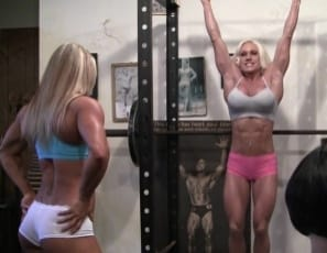 Bodybuilders Ashlee Chambers and Darkside Milinda work out and pose in the gym as Rikochan watches in awe, then offer to train her, showing off their ripped abs and bulging, vascular biceps. They put a mask on her and let her worship their muscular pecs, legs and glutes, then pull off her shirt and panties so she's naked. That's girl/girl/girl training.
